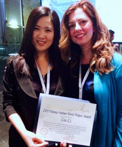 Anna Scaglione and Lin Li at the best paper award ceremony.